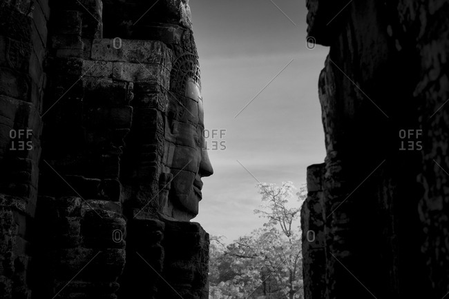 Profile view of a stone face in Prasat Bayon, Angkor Thom, Cambodia