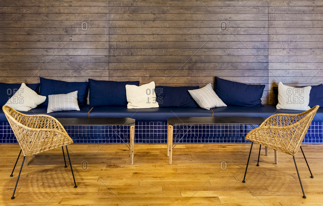 A blue bench seat on a wood wall
