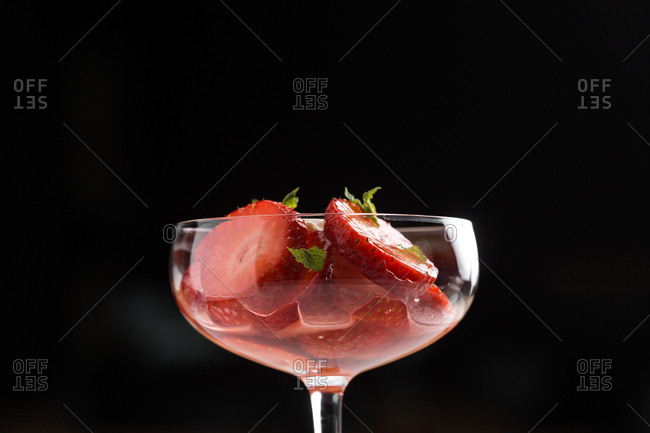Sliced strawberries served in a cocktail glass
