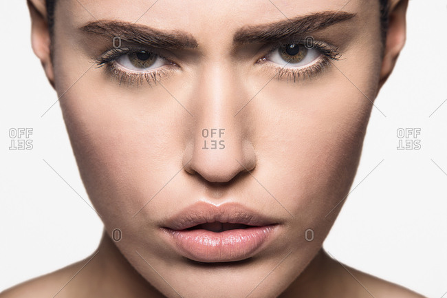 Close up on eyes and mouth of beautiful strong woman looking at camera with attitude