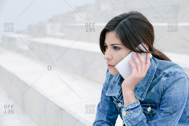 Young woman talking on her phone