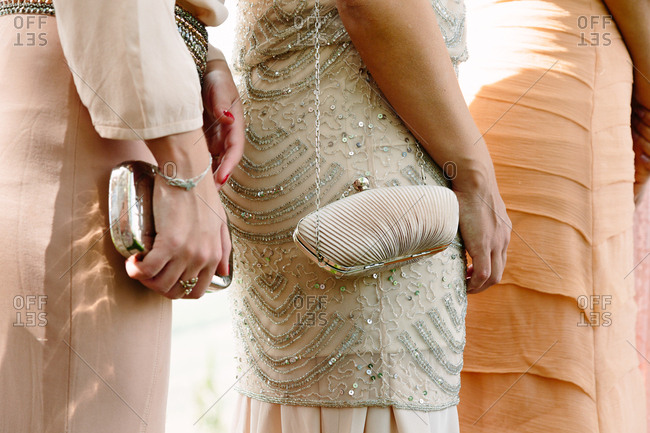 Details of wedding guests dress and handbags