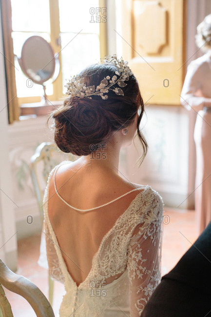View from behind of beautiful bride getting ready before wedding