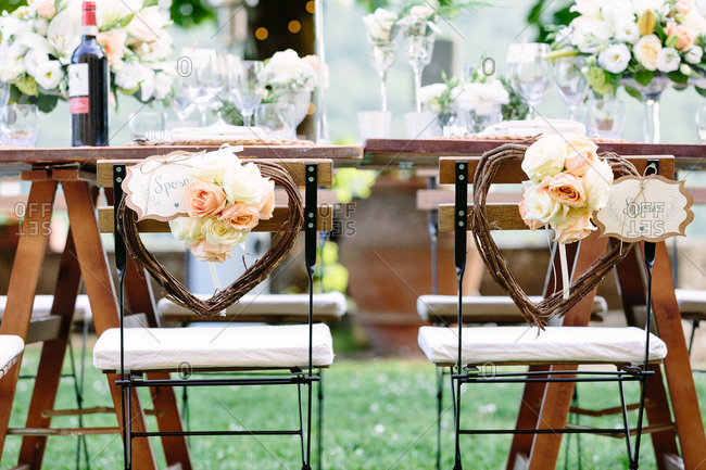 Bride and groom chairs at wedding reception