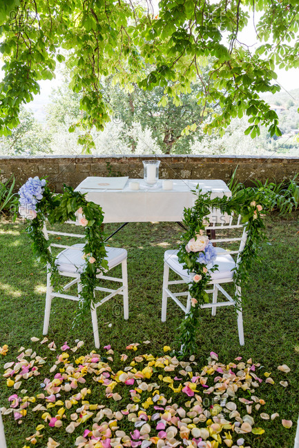 Bride and groom chairs at wedding ceremony in Italian garden