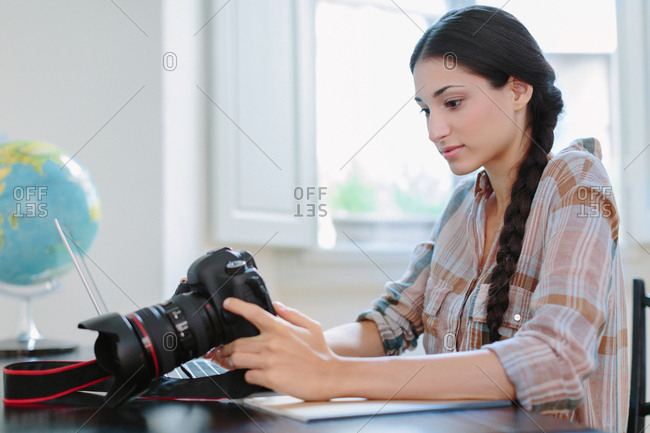 Young woman looking at a dslr