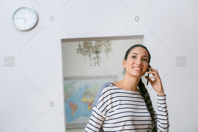 Young woman smiling and talking on the phone