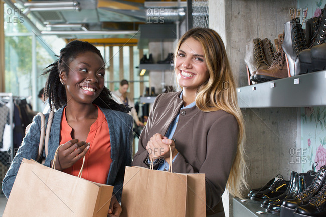 Two happy young women shopping