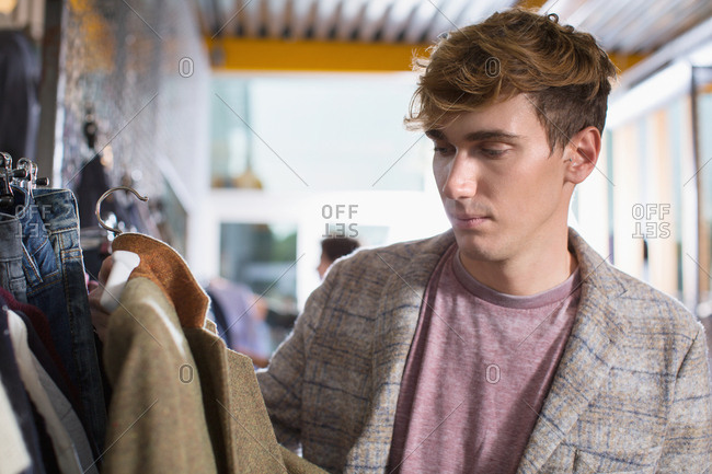 Young man looking at a jacket