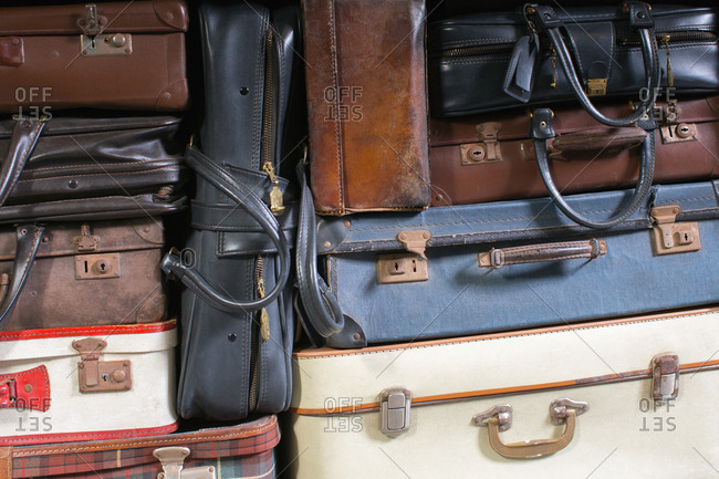 many suitcases stacked together