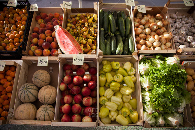 Variety of fresh fruits and vegetables in an outdoor market