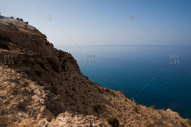 Rocky mountainside overlooking the blue Mediterranean Sea in Cyprus