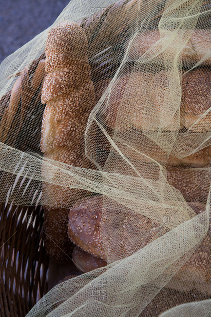 Basketful of arkatena rusk bread covered with mesh netting