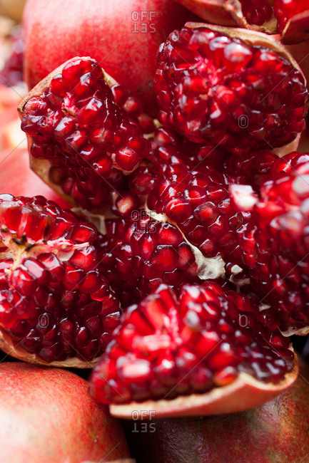 Seeds of a sliced open pomegranate at a market