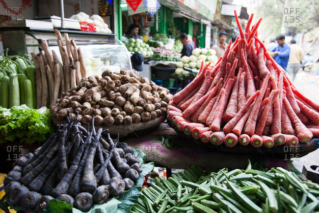 Delhi, India - March 1, 2007: Carrots and other produce carefully displayed in a market