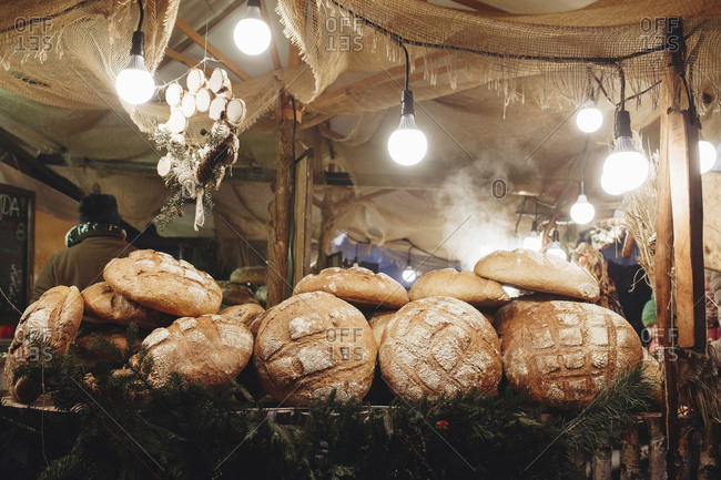 Krakow, Malopolska, Poland - December 16, 2016: Pile of loaves of bread on table in tent