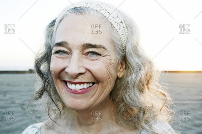 Portrait of smiling older Caucasian woman at beach