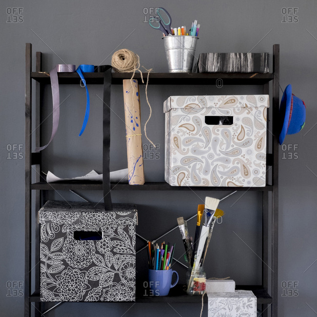 Boxes and art supplies on shelves