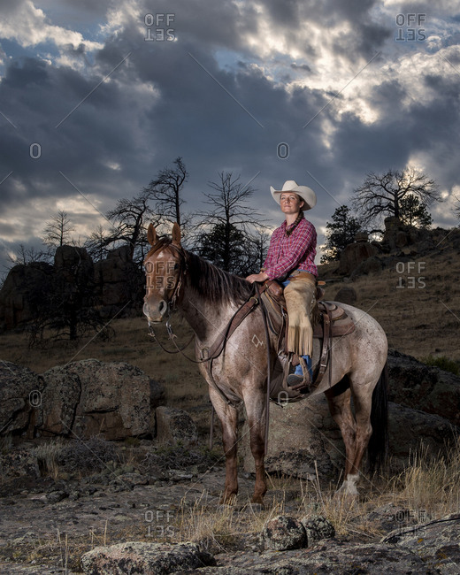 Portrait of Caucasian woman posing on horse