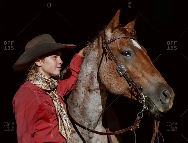 Portrait of Caucasian girl posing with horse