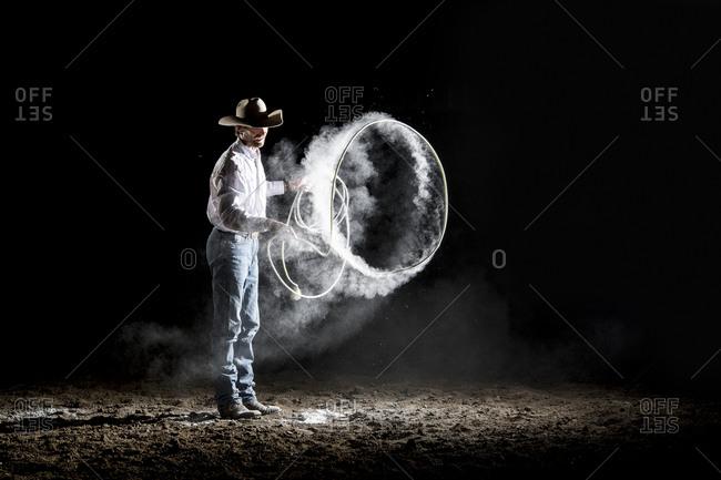 Caucasian cowboy spinning lasso - Offset