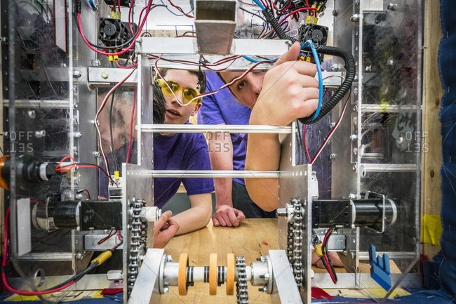 Caucasian boys wiring robotics in school