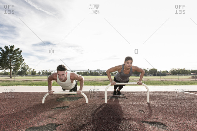 Couple doing push-ups outdoors