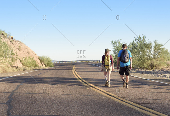 Couple hiking on winding street