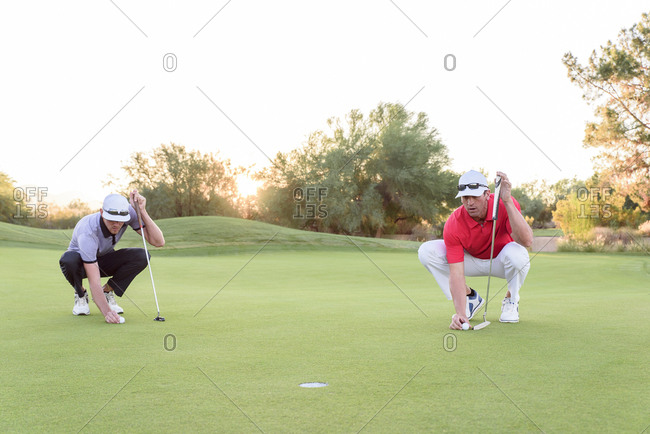 Golfers aiming on golf course