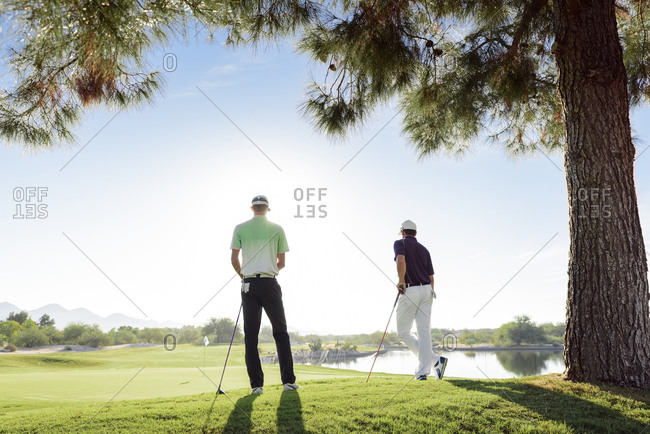 Friends standing on golf course