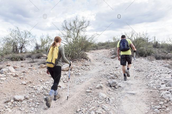 Couple hiking on rocky path