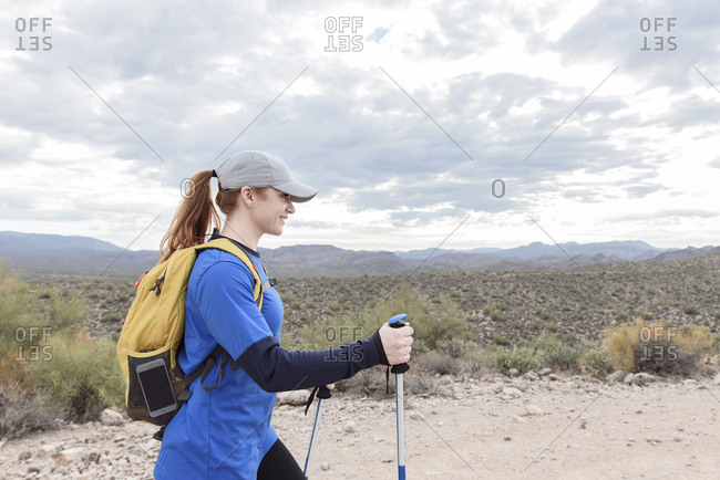 Caucasian woman hiking on rocky path in desert