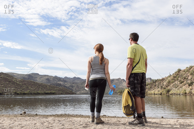 Hikers resting at lake