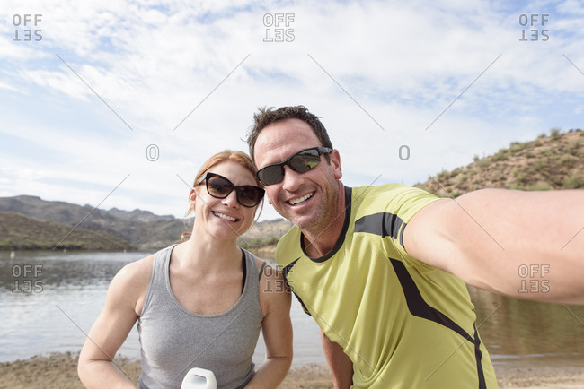 Couple posing for selfie at lake