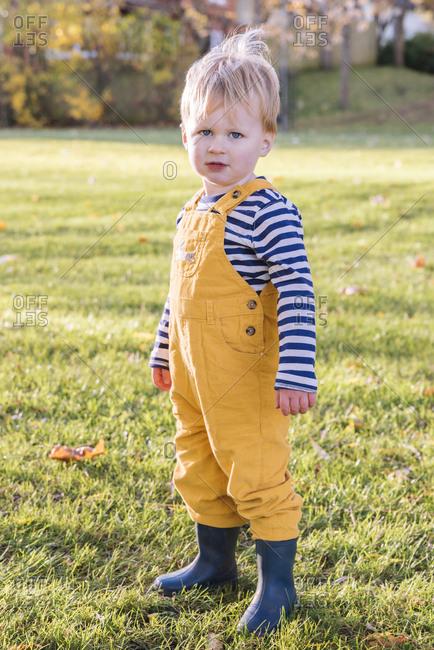 Portrait of Caucasian boy standing in field