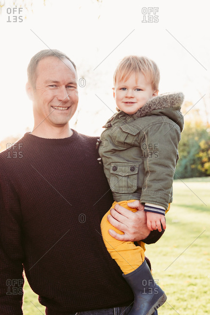 Portrait of Caucasian father posing with son