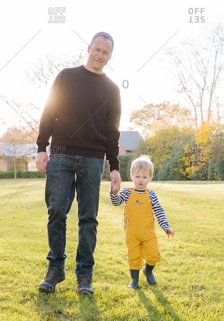 Caucasian father and son walking in field