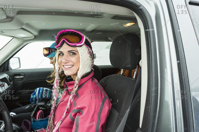 Portrait of smiling Caucasian woman in car in winter