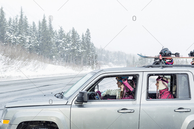 Friends driving in car in winter