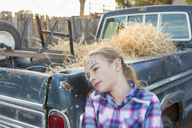 Caucasian girl leaning on truck