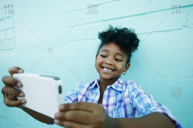 Black girl posing for cell phone selfie
