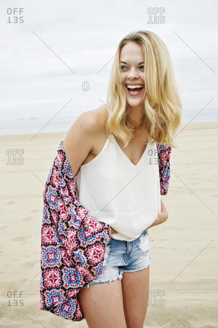 Laughing Caucasian women standing on beach