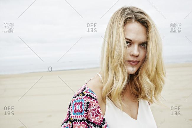 Portrait of serious Caucasian women on beach