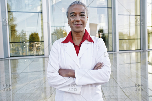 Portrait of smiling African American doctor outdoors at hospital