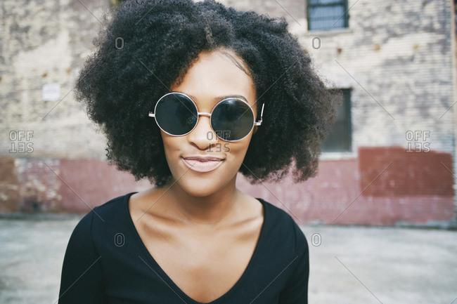Portrait of smiling Black woman outdoors