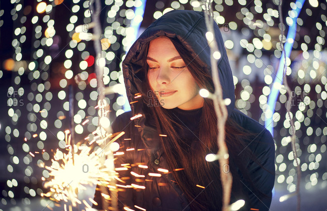Caucasian woman holding sparkler