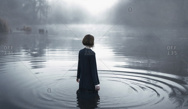 Woman wading in rippling river