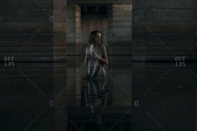 Caucasian woman standing waist deep in water