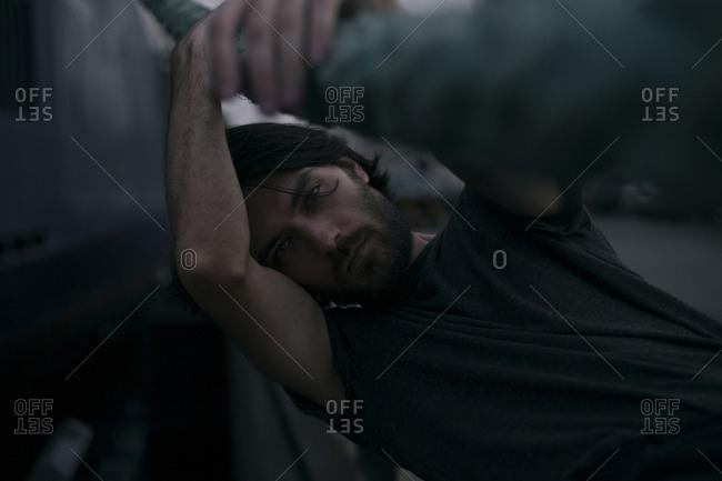 Depressed Caucasian man holding thick rope