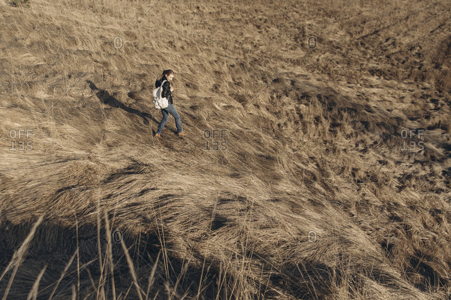 Middle Eastern woman walking on hill